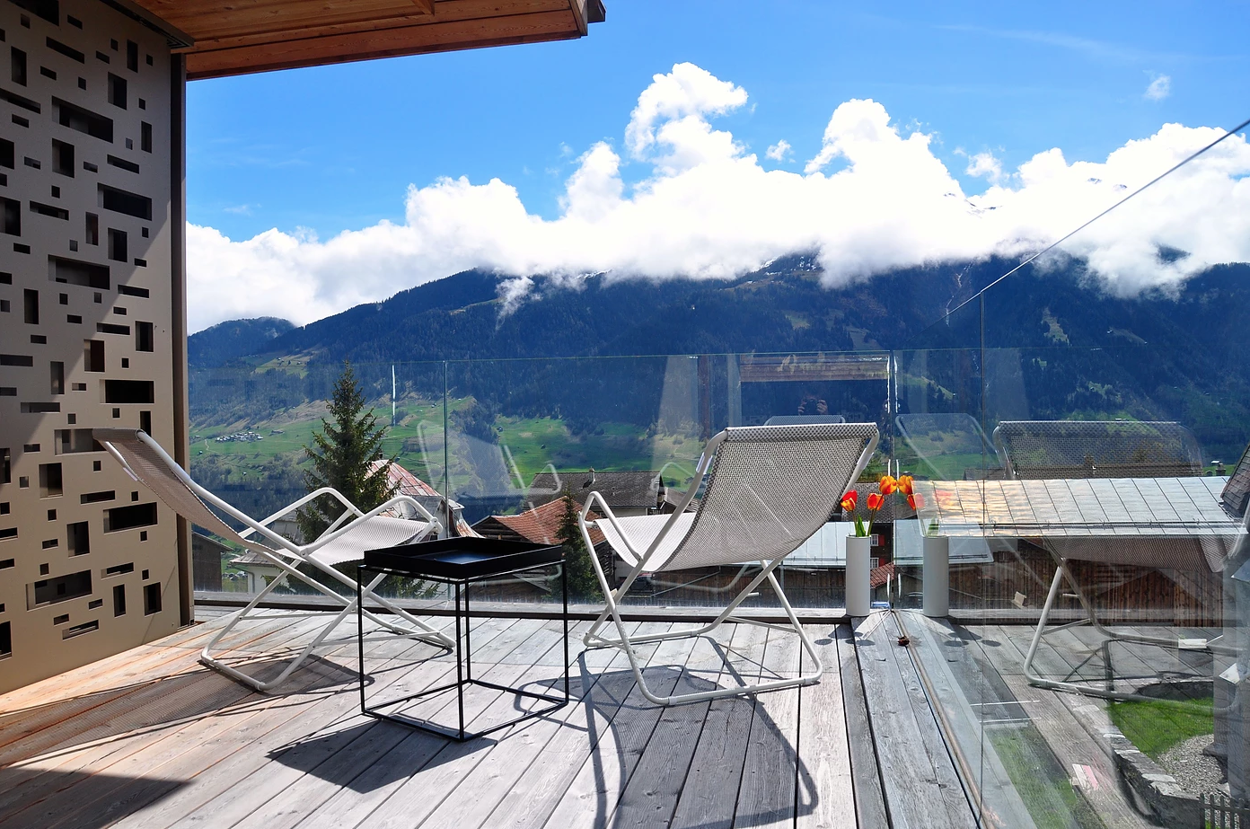 Situated in the alpine village of Vignongn, with views of the Val Lumneziz (Vally of Light), this eco-friendly, Scandi-inspired vacation home has a sunny terrace where you can enjoy views.  Photo 6 of 8 in 7 Alpine Holiday Chalets in Switzerland