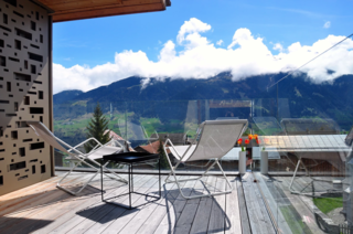 7 Alpine Holiday Chalets in Switzerland - Photo 5 of 7 - Situated in the alpine village of Vignongn, with views of the Val Lumneziz (Valley of Light), this eco-friendly, Scandi-inspired vacation home has a sunny terrace where you can enjoy views.