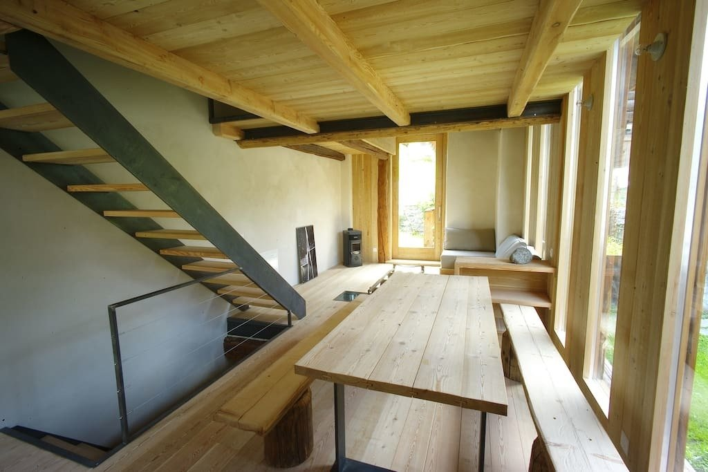This 17th centry barn in the historic core of Bregaglia in Grigioni was renovated with Sisal – a natural fiber flooring of coconut and marsh grass, in the bedrooms.