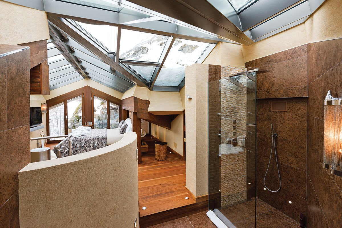 Built into the side of the mountain, Zermatt Peak is an expansive holiday retreat that has an indoor and outdoor Jacuzzi, gym, sauna, steam room and walk-in wine cellar. 7 Alpine Holiday Chalets in Switzerland - Photo 8 of 8