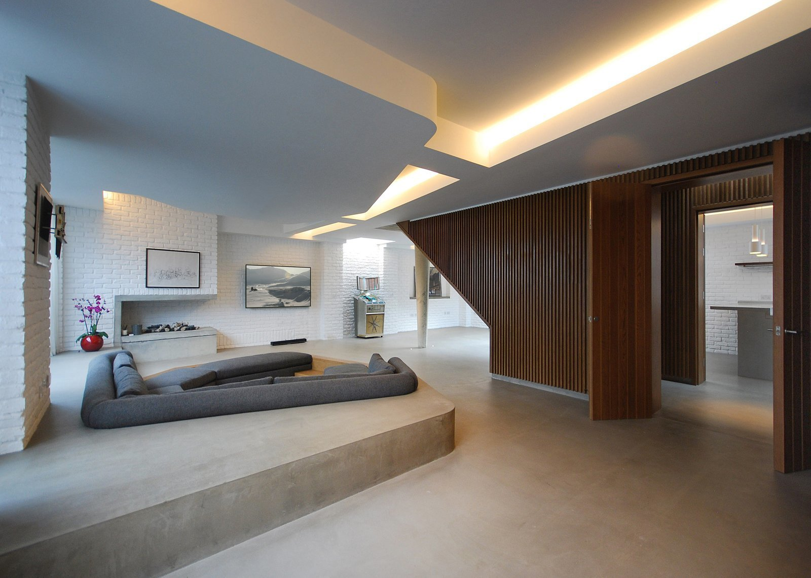 On a site surrounded by Victorian homes in Primrose Hill, Patalab Architecture transformed a former mechanic's garage into a three-bedroom house and two one-bedroom apartments.