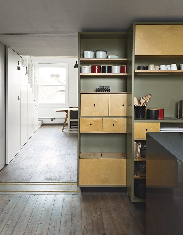 Architects Silvia Ullmayer and Allan Sylvester helped reinvent metalworker Simone ten Hompel's 576-square-foot flat, with a retractable skylight and streamlined storage under the stairs. Tagged: Storage Room, Cabinet Storage Type, and Shelves Storage Type.  Photo 7 of 9 in 8 Stylish London Apartments