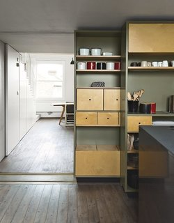 8 Stylish London Apartments - Photo 6 of 8 - Architects Silvia Ullmayer and Allan Sylvester helped reinvent metalworker Simone ten Hompel's 576-square-foot flat with a retractable skylight and smart storage systems.