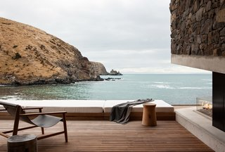 Stay at a Stone-and-Glass Retreat in a Remote New Zealand Bay - Photo 1 of 10 -