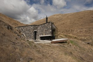 Stay at a Stone-and-Glass Retreat in a Remote New Zealand Bay - Photo 2 of 10 -