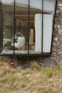 Stay at a Stone-and-Glass Retreat in a Remote New Zealand Bay - Photo 8 of 10 -