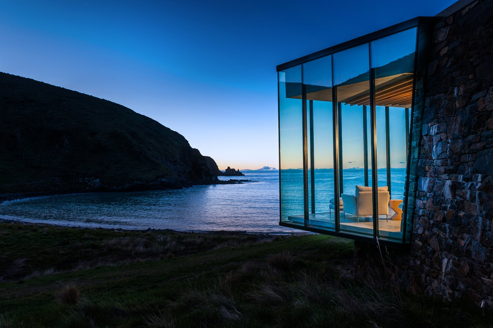 Tagged: Windows, Metal, and Picture Window Type.  Photo 9 of 10 in Stay at a Stone-and-Glass Retreat in a Remote New Zealand Bay