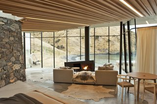 Stay at a Stone-and-Glass Retreat in a Remote New Zealand Bay - Photo 7 of 10 -