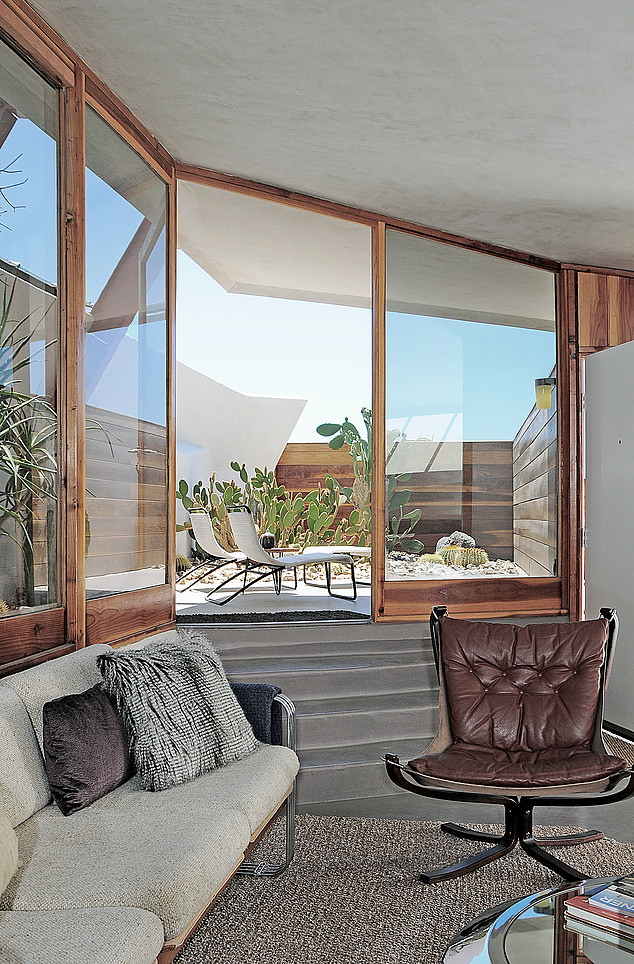 Tagged: Living Room, Sofa, Chair, and Concrete Floor.  Photo 6 of 13 in Escape to a John Lautner Micro-Resort in the Californian Desert