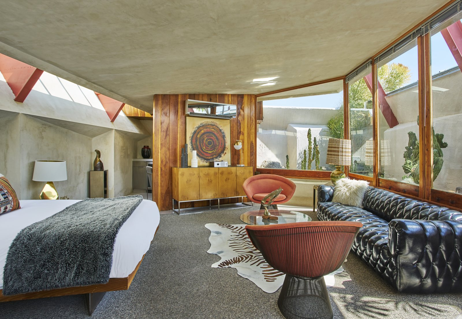 Tagged: Bedroom, Bed, Chair, Lamps, Carpet Floor, Rug Floor, Table Lighting, and Storage.  Photo 8 of 13 in Escape to a John Lautner Micro-Resort in the Californian Desert