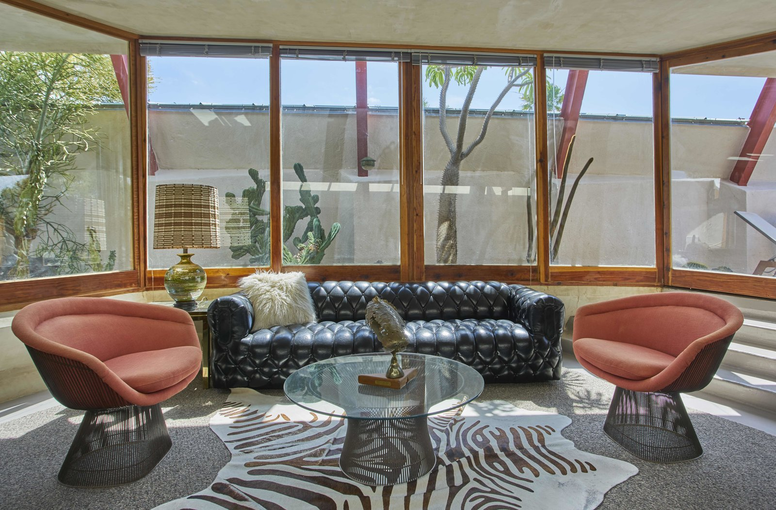 Tagged: Living Room, Sofa, Lamps, Chair, Coffee Tables, End Tables, Rug Floor, Carpet Floor, Concrete Floor, and Table Lighting.  Photo 12 of 13 in Escape to a John Lautner Micro-Resort in the Californian Desert
