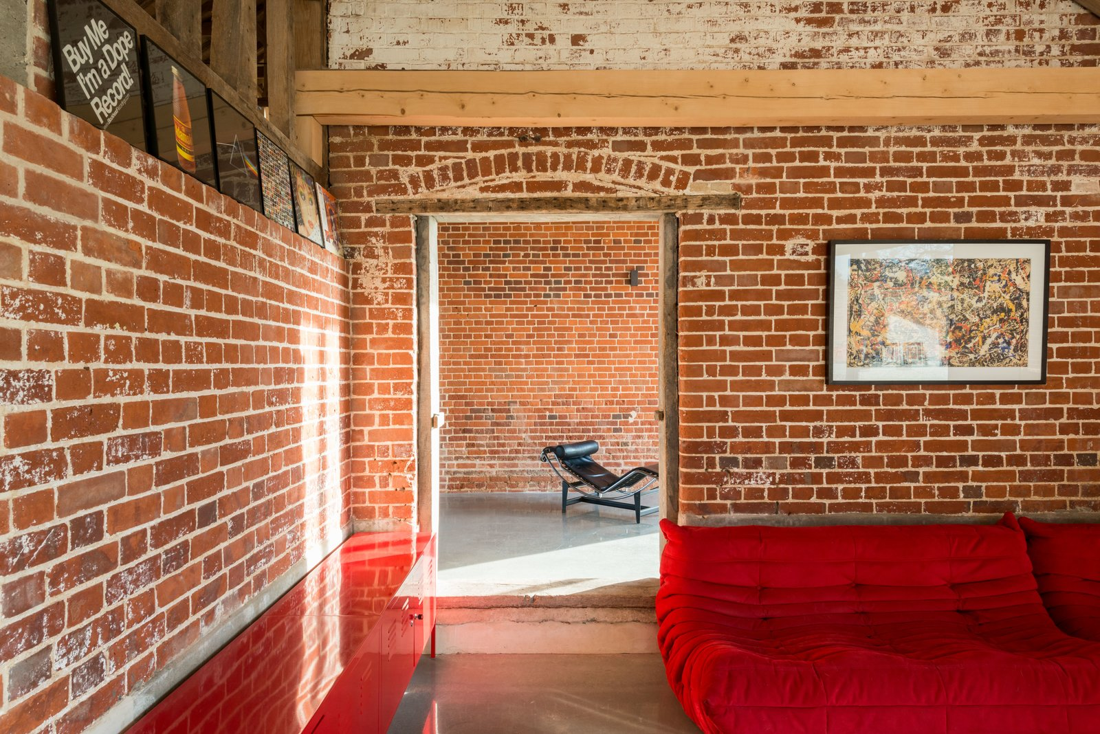 Tagged: Living Room, Sectional, Chair, and Concrete Floor.  Photo 9 of 10 in A Suffolk Barn Home With Soaring Ceilings Listed at $1.95M