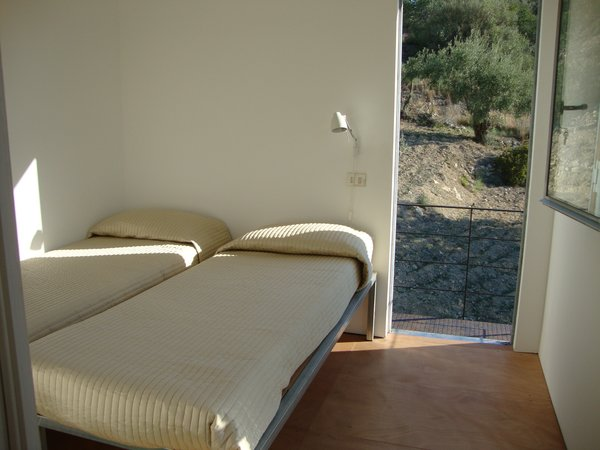 Modern home with bedroom, wall lighting, medium hardwood floor, and bed. Photo 10 of Sea View Villa