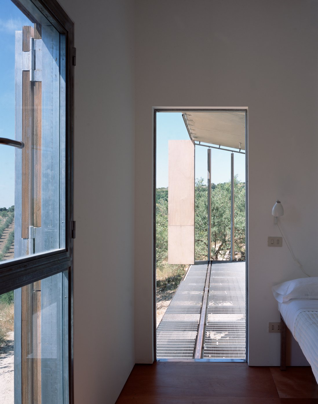 Tagged: Hallway and Dark Hardwood Floor.  Photo 10 of 12 in Stay in a Minimalist Villa in the Sicilian Countryside, Complete With Sea Views
