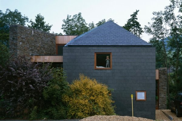 Modern home with outdoor, trees, hardscapes, and side yard. Photo 3 of Ty Hedfan