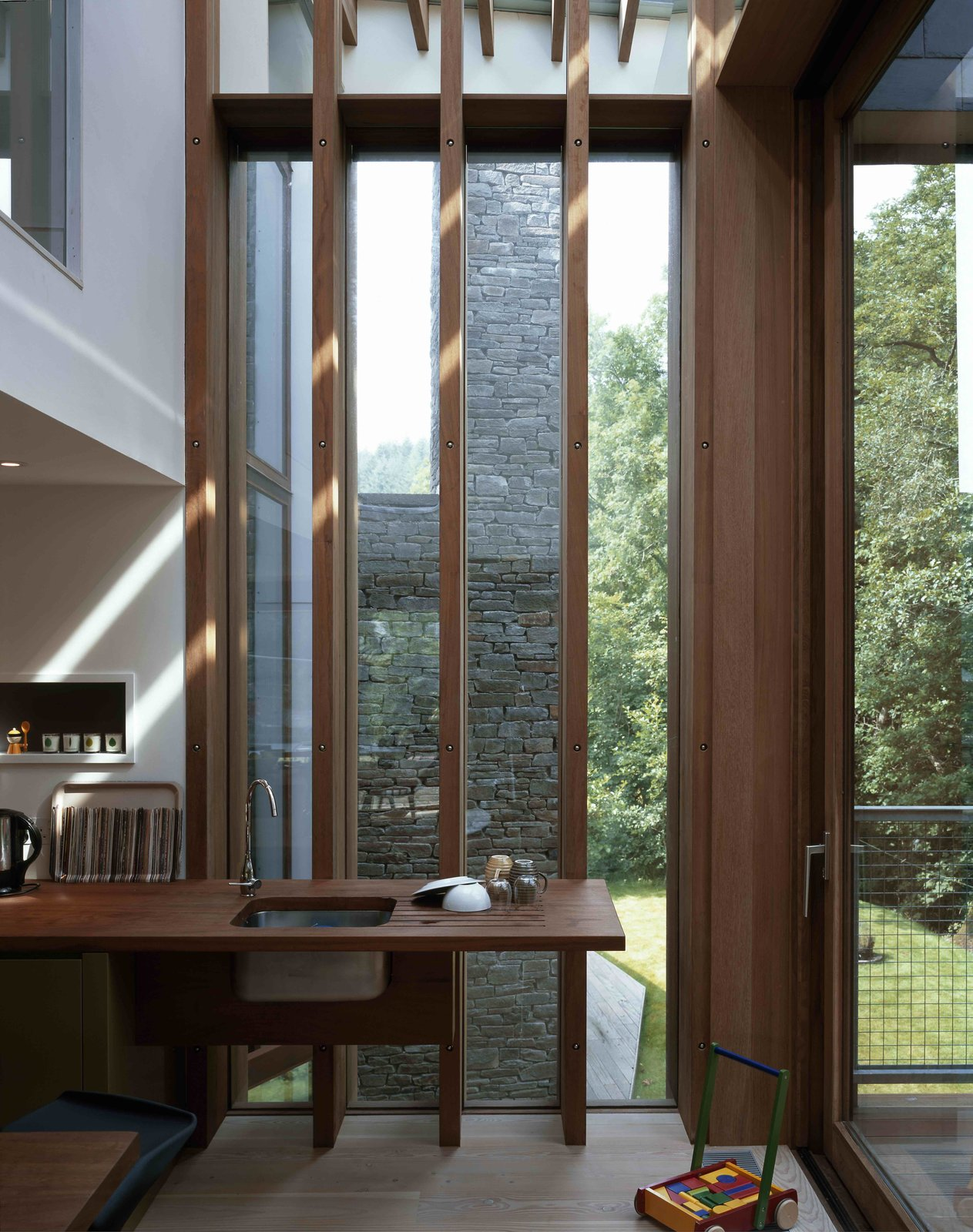 Tagged: Kitchen, Wood Counter, Light Hardwood Floor, and Drop In Sink.  Ty Hedfan by Dwell from A Hovering House in the Welsh Hills That You Can Call Your Own For a Week