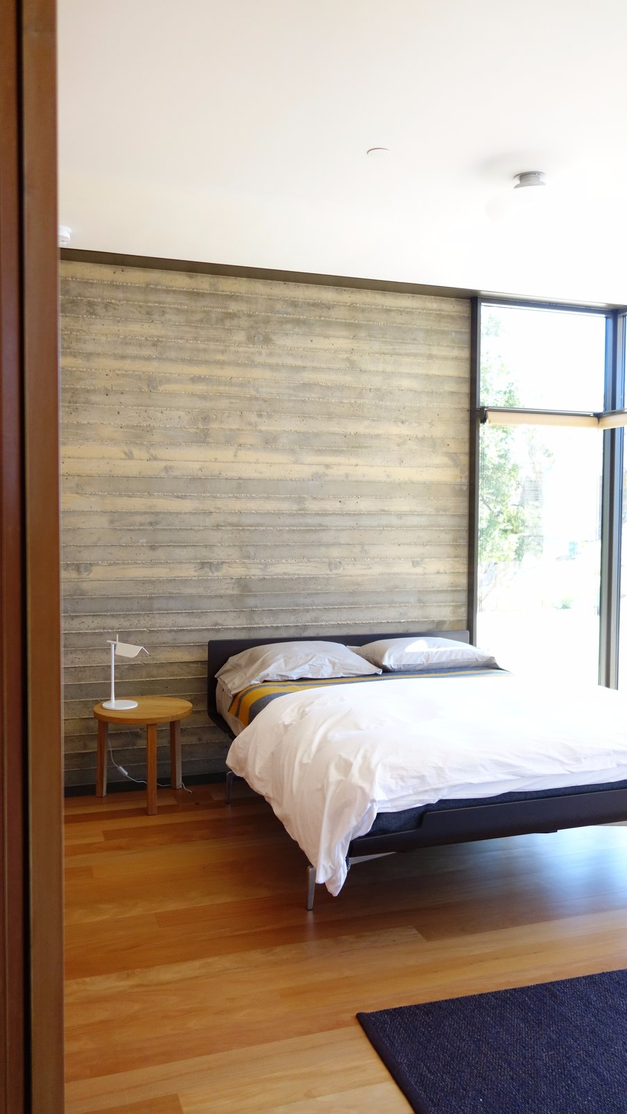 Tagged: Bedroom, Bed, Night Stands, and Medium Hardwood Floor.  Photo 8 of 13 in Take Your Next Vacation in a Midcentury Home in the Santa Monica Mountains