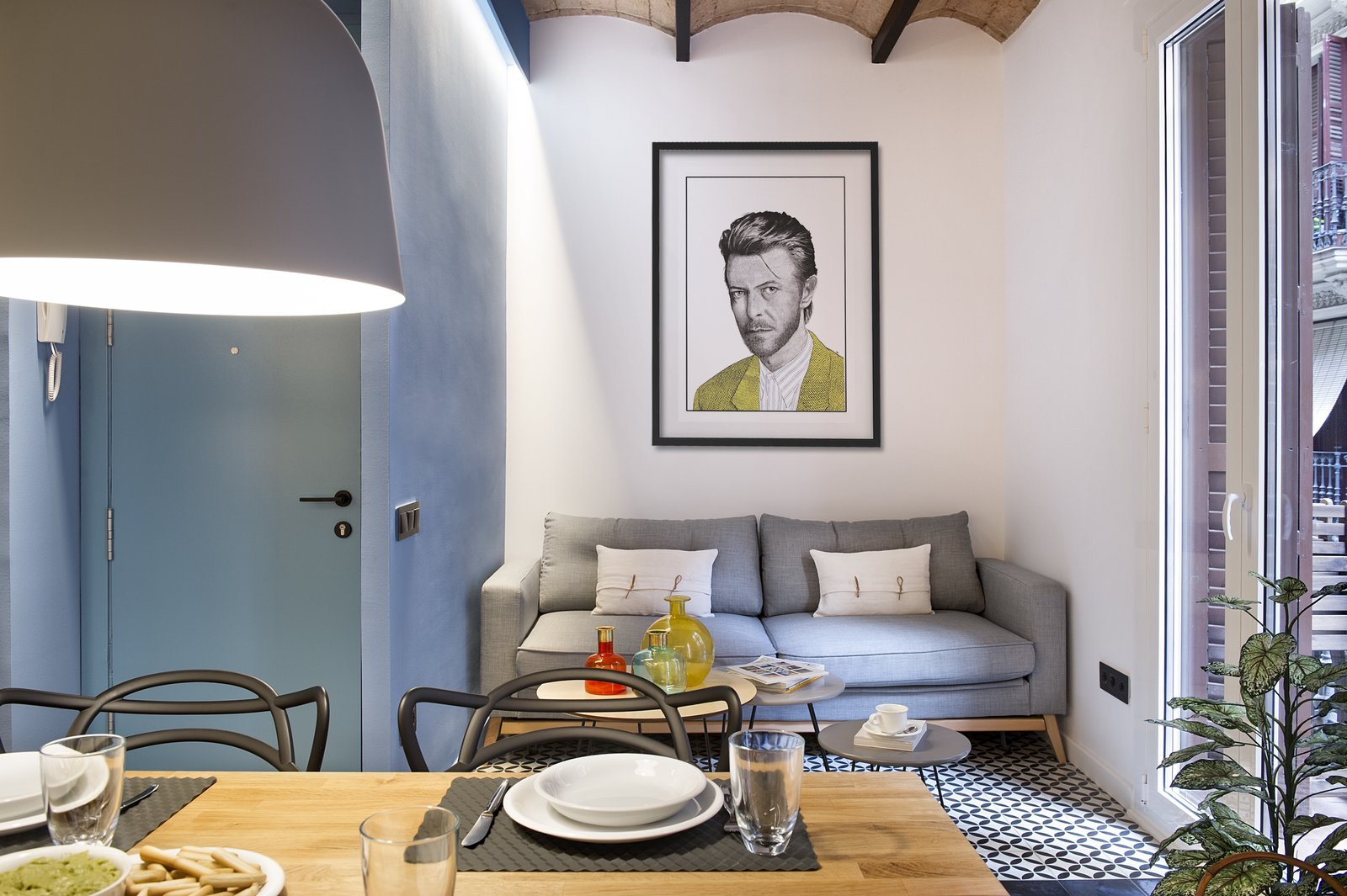 Tagged: Living Room, Coffee Tables, Pendant Lighting, and Sofa. A Smart Layout Maximizes Space in This Compact Urban Beach Apartment in Barcelona - Photo 3 of 11