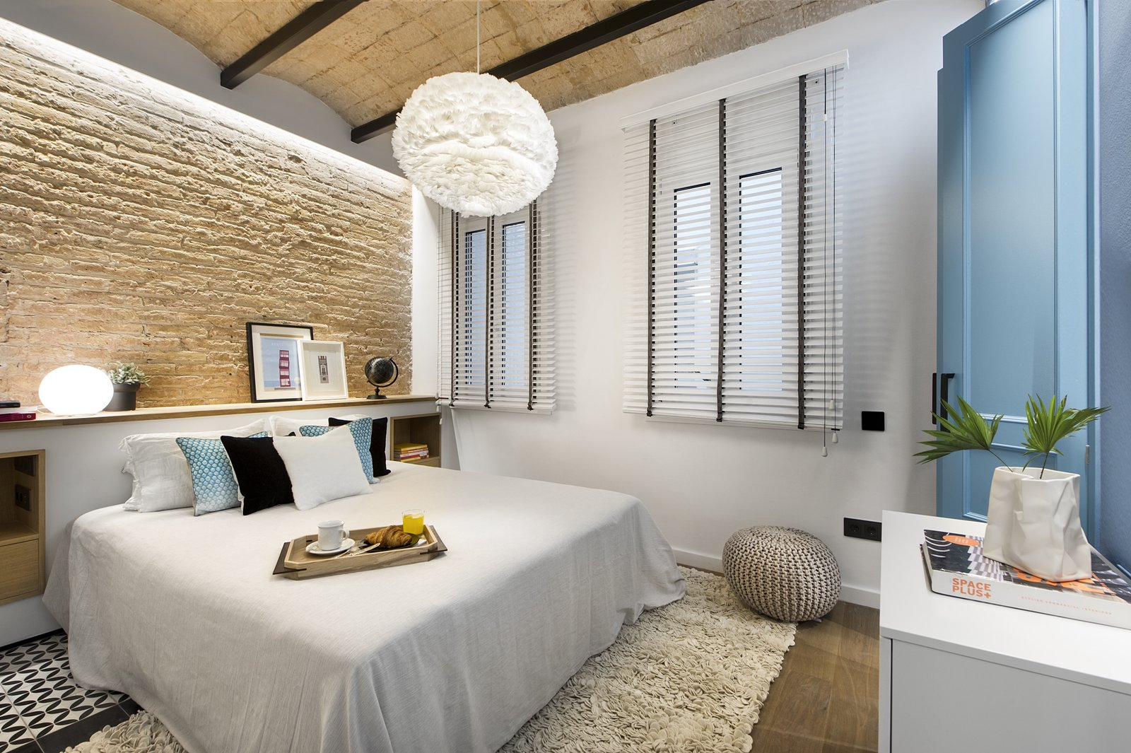 Tagged: Bedroom, Bed, Dresser, Storage, Pendant Lighting, Medium Hardwood Floor, and Ceramic Tile Floor.  Photo 5 of 11 in A Smart Layout Maximizes Space in This Compact Urban Beach Apartment in Barcelona
