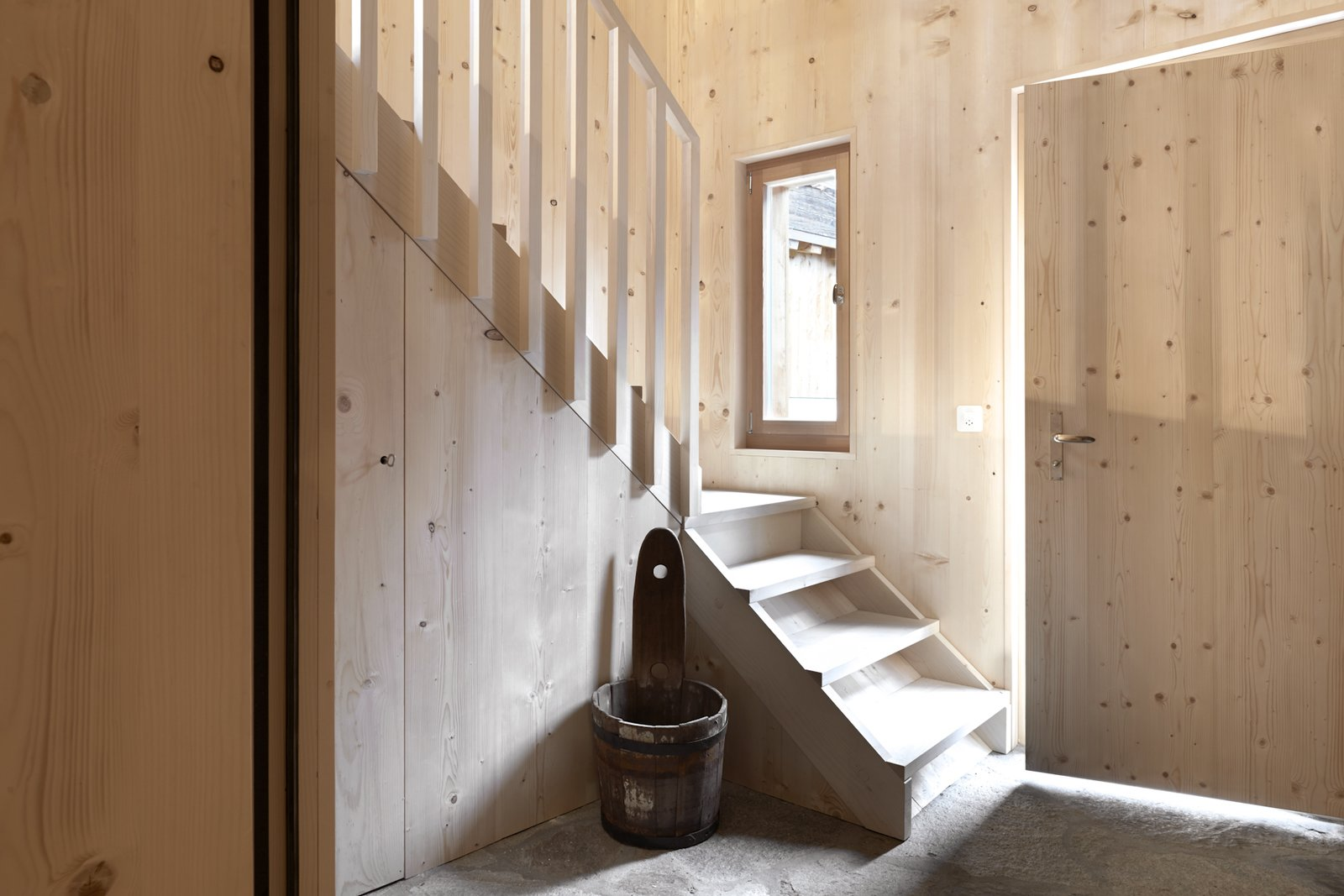 Tagged: Staircase, Wood Tread, and Wood Railing. A Renovated Pagan House in the Swiss Alps Puts Guests in Touch With the Past - Photo 7 of 13