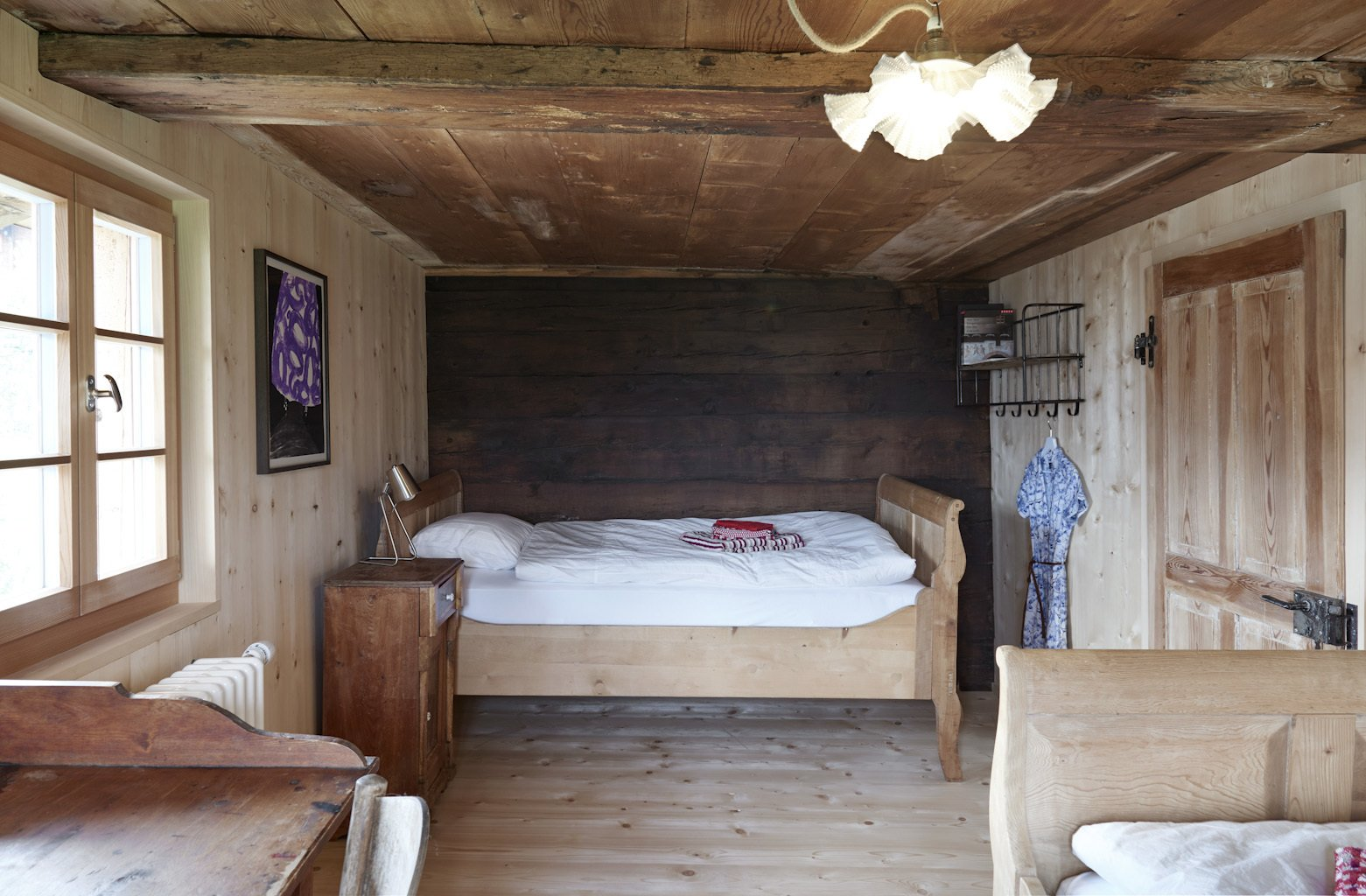 Tagged: Bedroom, Night Stands, and Bed.  Photo 8 of 13 in A Renovated Pagan House in the Swiss Alps Puts Guests in Touch With the Past