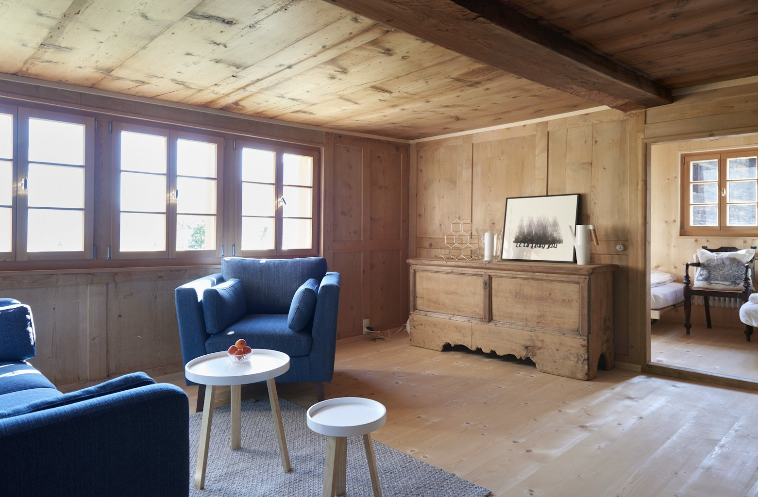 Tagged: Living Room, Console Tables, Sofa, Chair, Light Hardwood Floor, and Coffee Tables.  Photo 10 of 13 in A Renovated Pagan House in the Swiss Alps Puts Guests in Touch With the Past