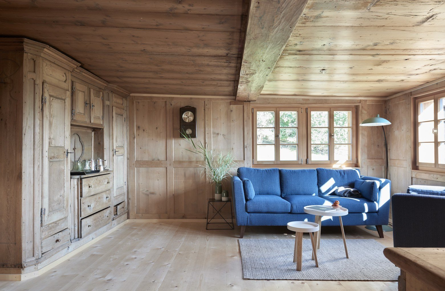Tagged: Living Room, Light Hardwood Floor, Sofa, and End Tables.  Photo 4 of 13 in A Renovated Pagan House in the Swiss Alps Puts Guests in Touch With the Past