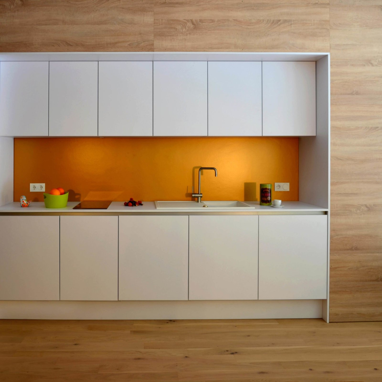 Tagged: Kitchen, Light Hardwood Floor, White Cabinet, and Drop In Sink.  Refugium Betzenstein by Dwell from Escape to a Bio-Passive Vacation Refuge in a Bavarian Nature Park
