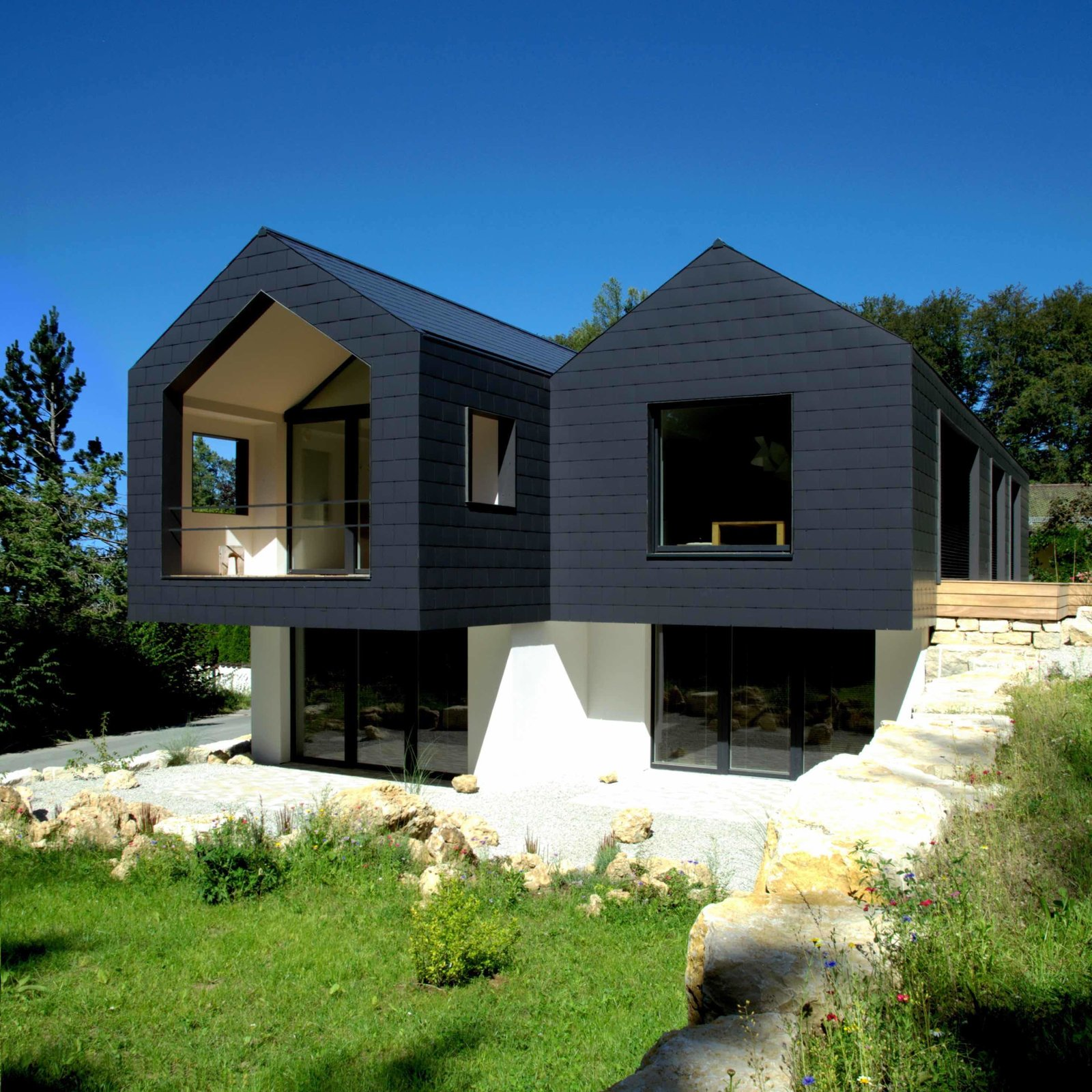 Tagged: Outdoor, Trees, Grass, Front Yard, and Boulders. Refugium Betzenstein by Dwell