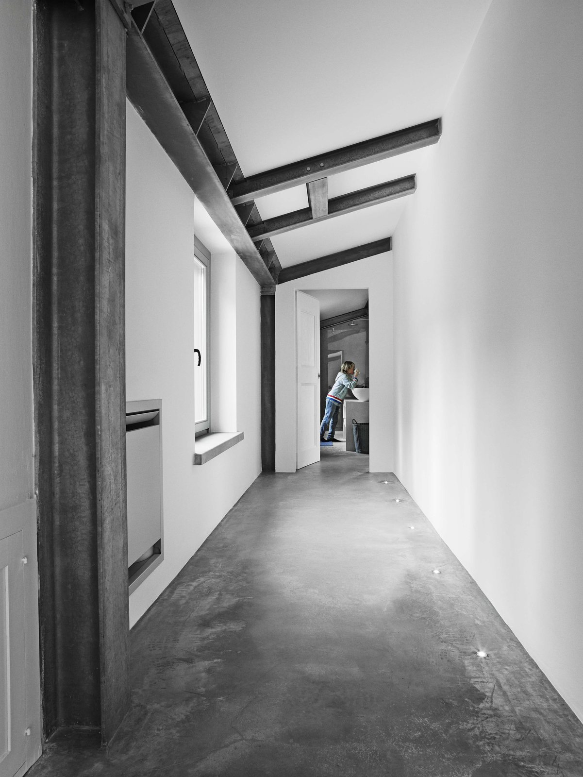Tagged: Hallway and Concrete Floor.  Photo 5 of 11 in Stay in a Modern, Industrial Home That's Hidden Inside a Traditional Tuscan Villa