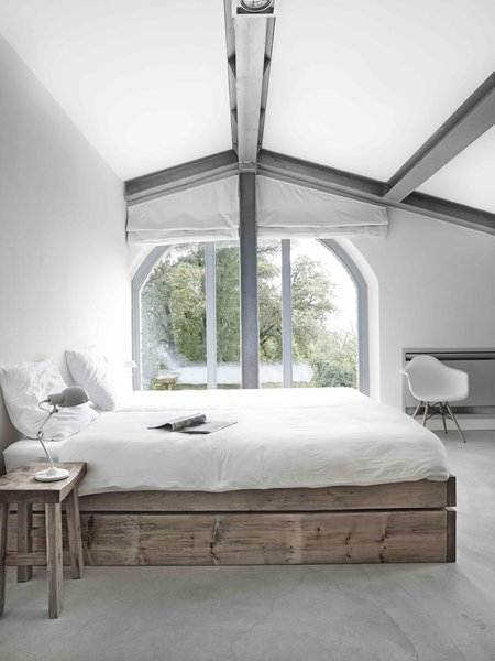 Tagged: Concrete Floor and Bed.  Photo 6 of 11 in Stay in a Modern, Industrial Home That's Hidden Inside a Traditional Tuscan Villa