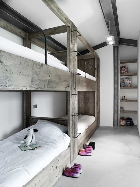 Tagged: Kids Room, Bed, Concrete Floor, Bedroom, Pre-Teen Age, Neutral Gender, Shelves, and Bunks.  Photo 7 of 11 in Stay in a Modern, Industrial Home That's Hidden Inside a Traditional Tuscan Villa