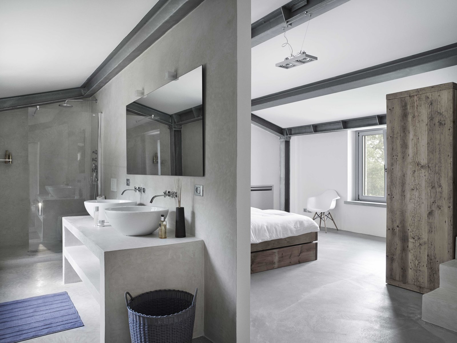 Tagged: Bath Room, Concrete Counter, Concrete Floor, Vessel Sink, Enclosed Shower, Concrete Wall, Corner Shower, Wall Lighting, and Pendant Lighting.  Photo 8 of 11 in Stay in a Modern, Industrial Home That's Hidden Inside a Traditional Tuscan Villa