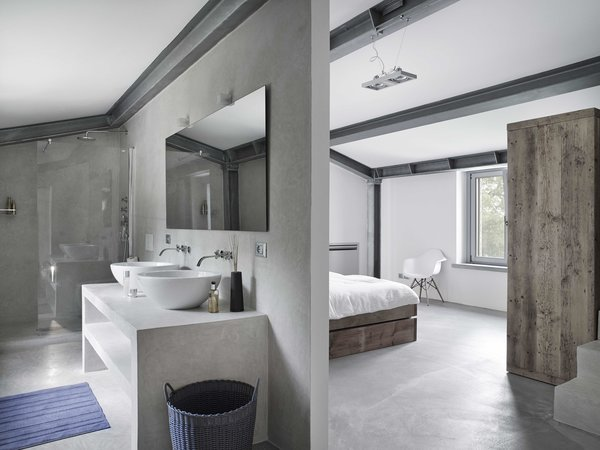 Tagged: Concrete Floor.  Photo 8 of 11 in Stay in a Modern, Industrial Home That's Hidden Inside a Traditional Tuscan Villa