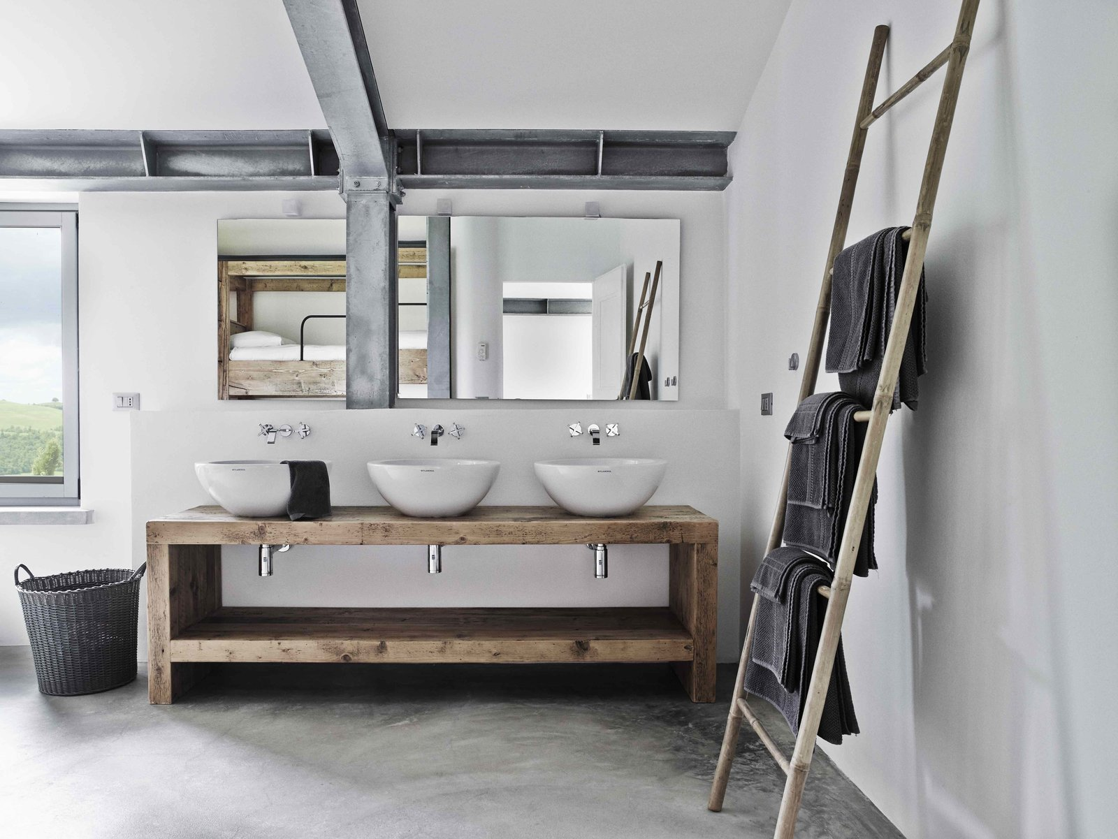 Tagged: Bath Room, Wood Counter, Concrete Floor, Vessel Sink, and Wall Lighting.  Photo 9 of 11 in Stay in a Modern, Industrial Home That's Hidden Inside a Traditional Tuscan Villa