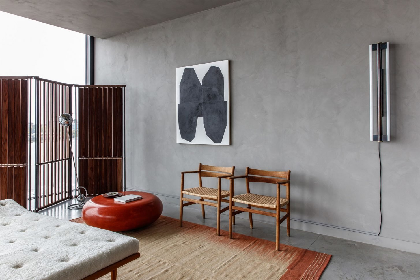 Tagged: Living Room, Ottomans, Chair, Recliner, Accent Lighting, Wall Lighting, and Concrete Floor.  Photo 13 of 13 in For Just Under $2 Million, You Could Live in a London Penthouse Outfitted by Cereal Magazine