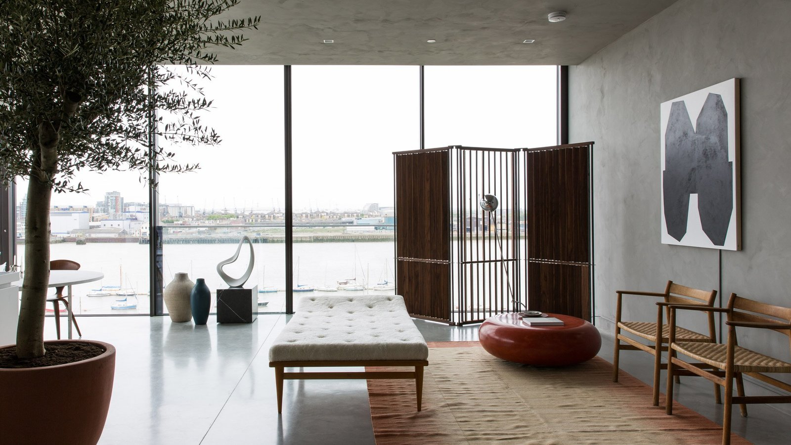 Tagged: Living Room, Chair, Recliner, Recessed Lighting, and Concrete Floor. For Just Under $2 Million, You Could Live in a London Penthouse Outfitted by Cereal Magazine - Photo 5 of 13
