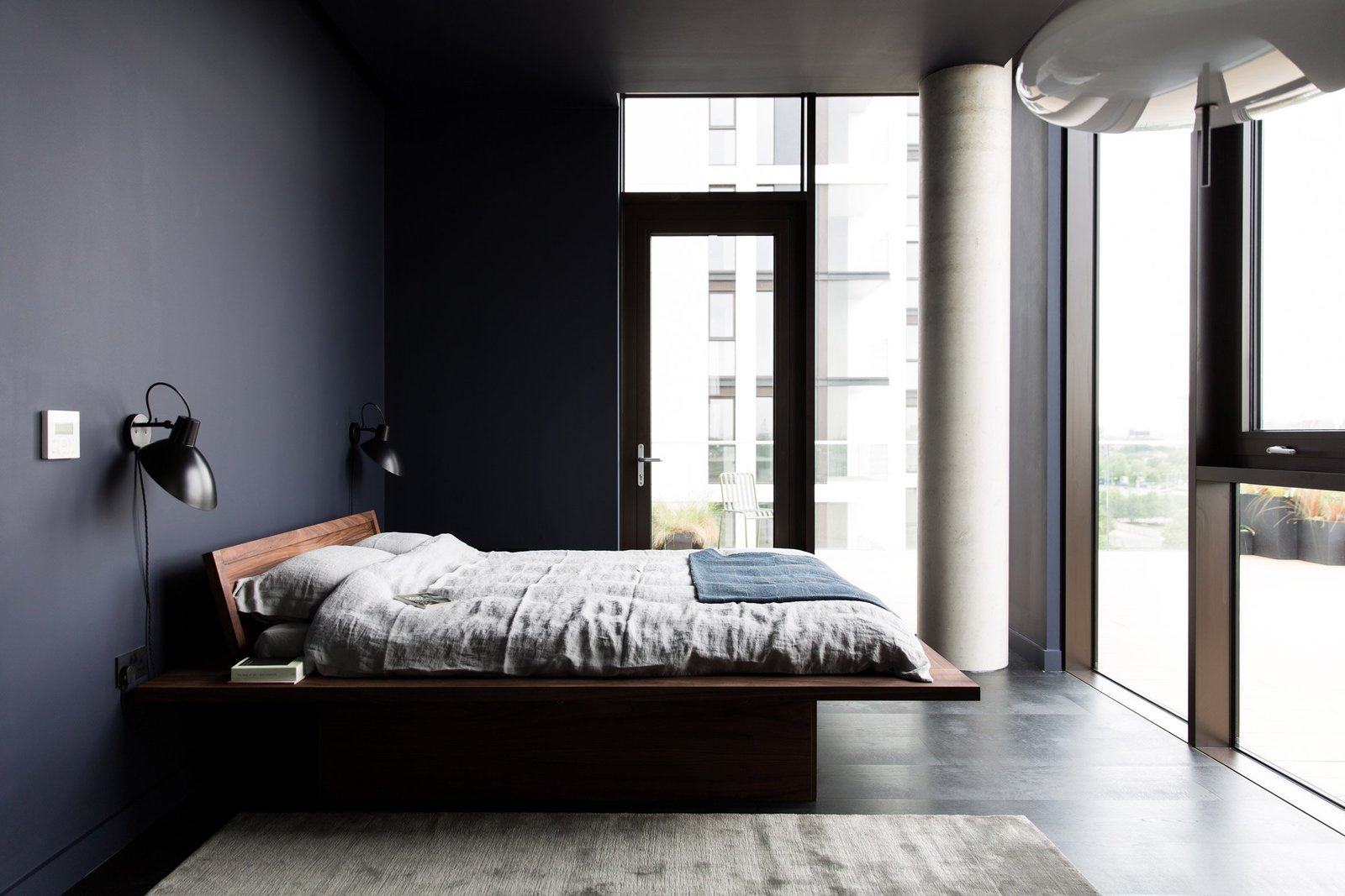 Tagged: Bedroom, Bed, Wall Lighting, and Dark Hardwood Floor.  Photo 8 of 13 in For Just Under $2 Million, You Could Live in a London Penthouse Outfitted by Cereal Magazine