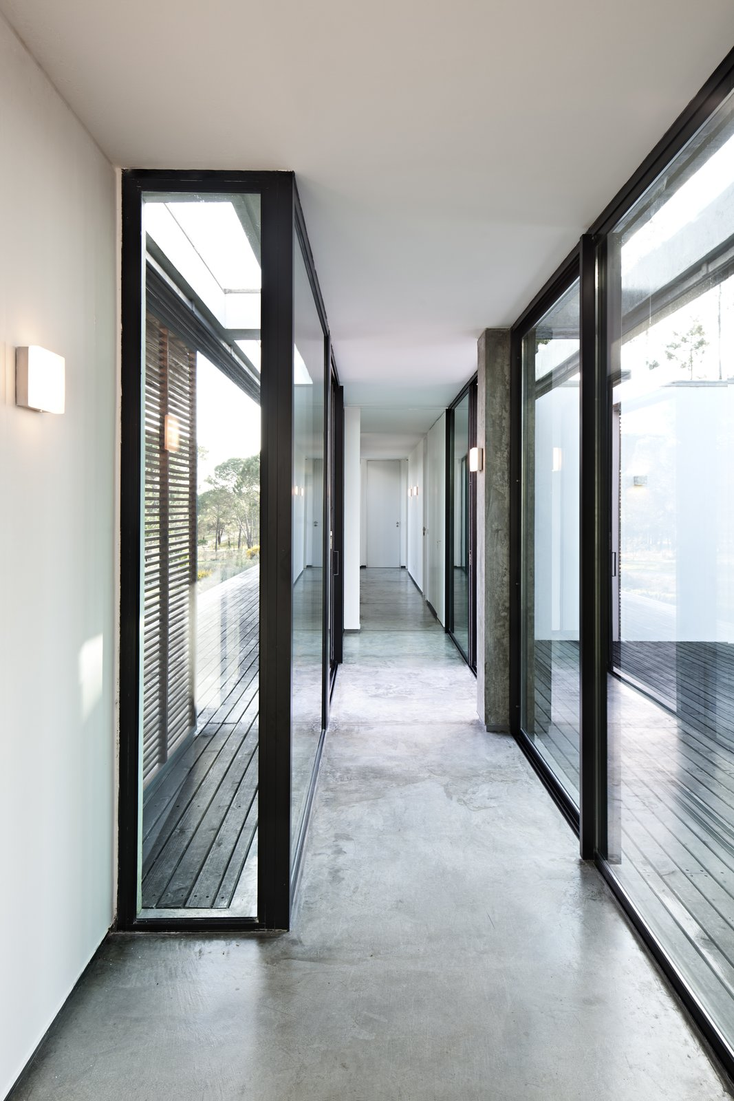 Tagged: Hallway and Concrete Floor.  Photo 5 of 15 in Escape to a Light-Filled, Beach-Meets-Forest Retreat in Portugal
