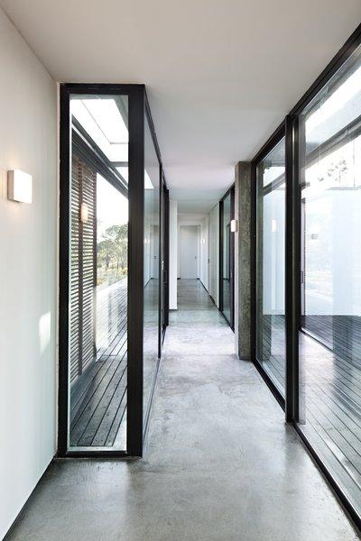 Modern home with hallway and concrete floor. Photo 5 of Villa Caetana
