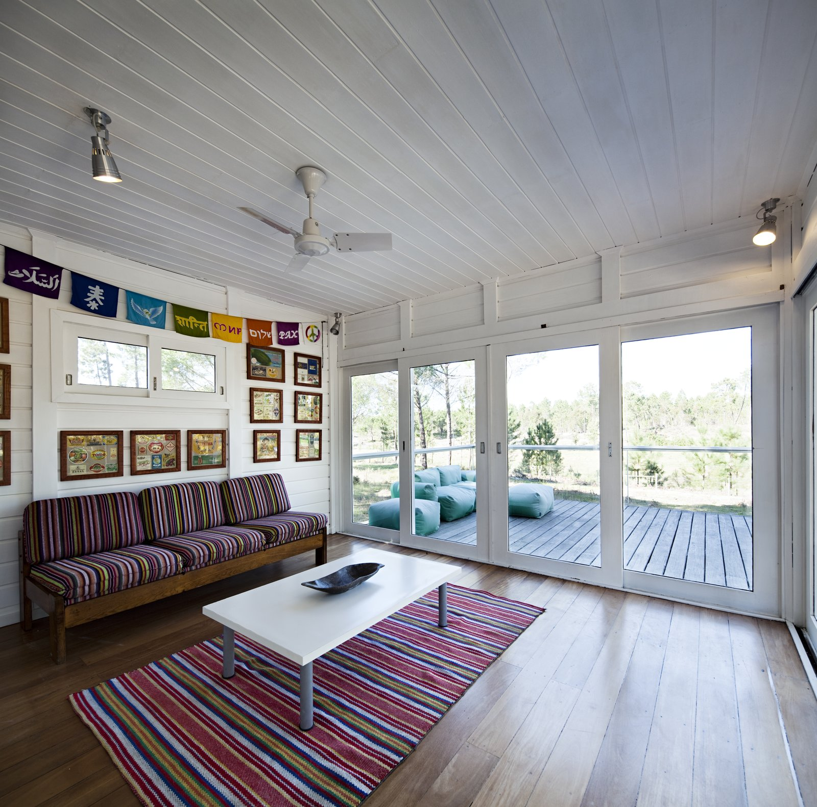 Tagged: Living Room, Sofa, Coffee Tables, Ceiling Lighting, Medium Hardwood Floor, and Rug Floor.  Photo 9 of 15 in Escape to a Light-Filled, Beach-Meets-Forest Retreat in Portugal
