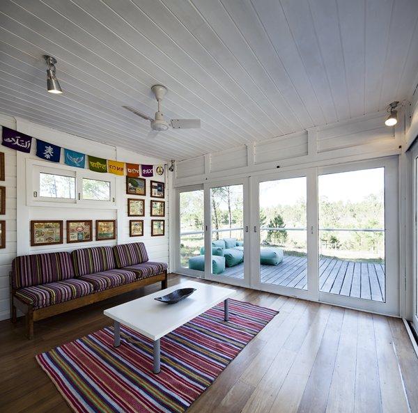 Modern home with living room, sofa, coffee tables, ceiling lighting, and medium hardwood floor. Photo 9 of Villa Caetana