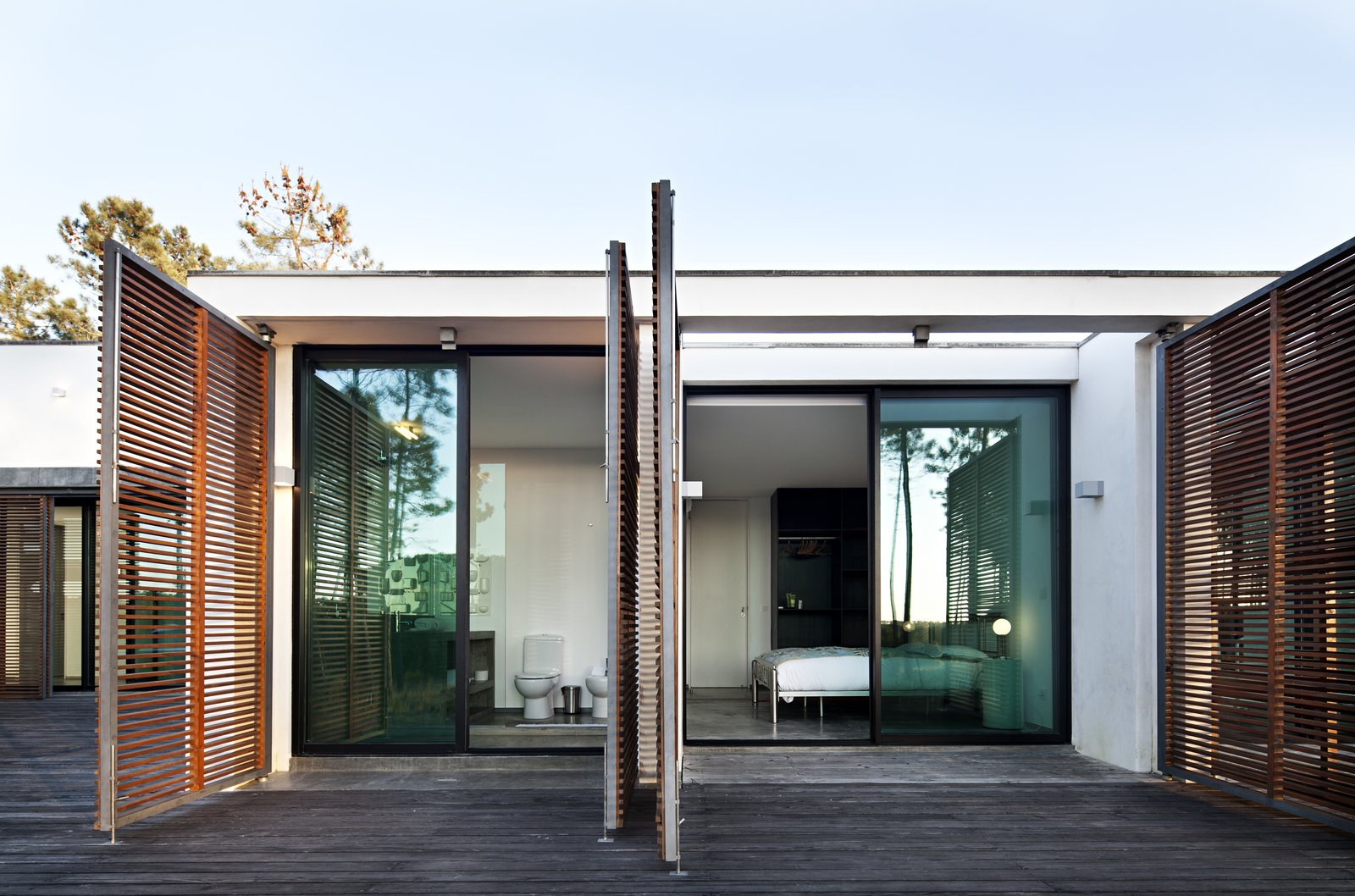 Tagged: Side Yard, Wood Patio, Porch, Deck, Doors, Exterior, Swing Door Type, Wood, Sliding Door Type, and Metal.  Photo 10 of 15 in Escape to a Light-Filled, Beach-Meets-Forest Retreat in Portugal