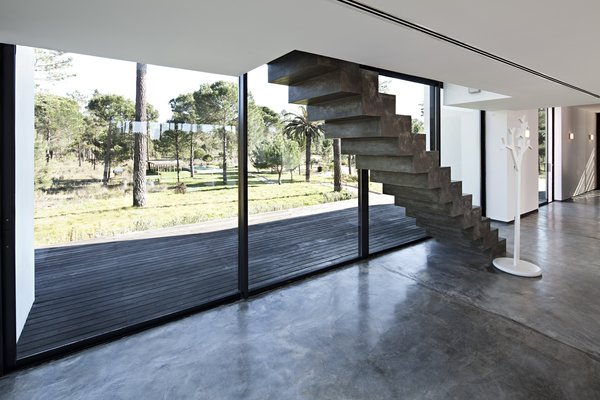Modern home with staircase and concrete tread. Photo 11 of Villa Caetana