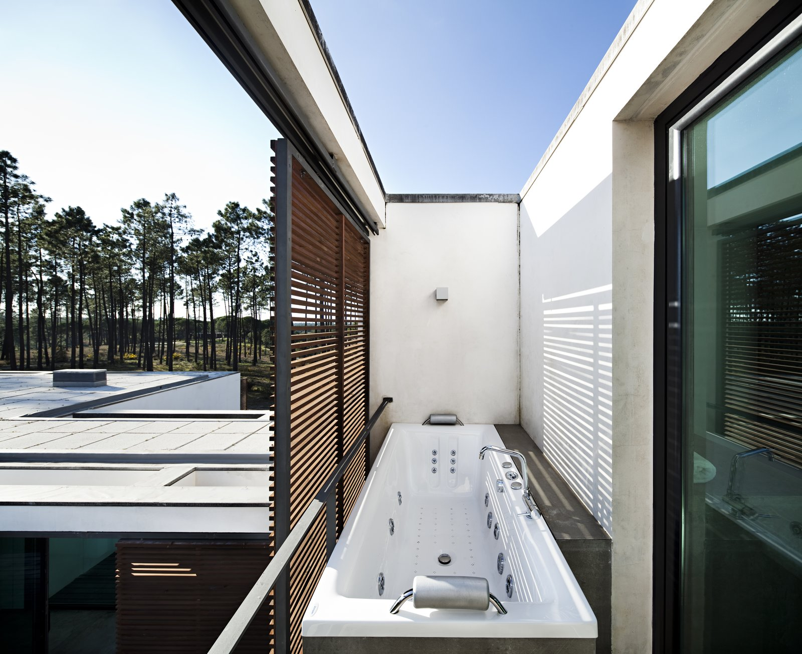 Tagged: Bath Room, Drop In Tub, and Wall Lighting.  Photo 12 of 15 in Escape to a Light-Filled, Beach-Meets-Forest Retreat in Portugal