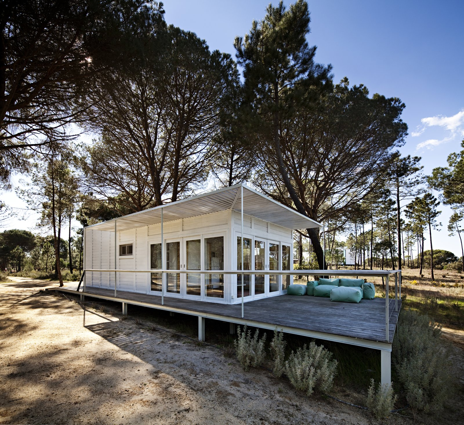 Tagged: Exterior, Cabin Building Type, and Flat RoofLine.  Photo 14 of 15 in Escape to a Light-Filled, Beach-Meets-Forest Retreat in Portugal
