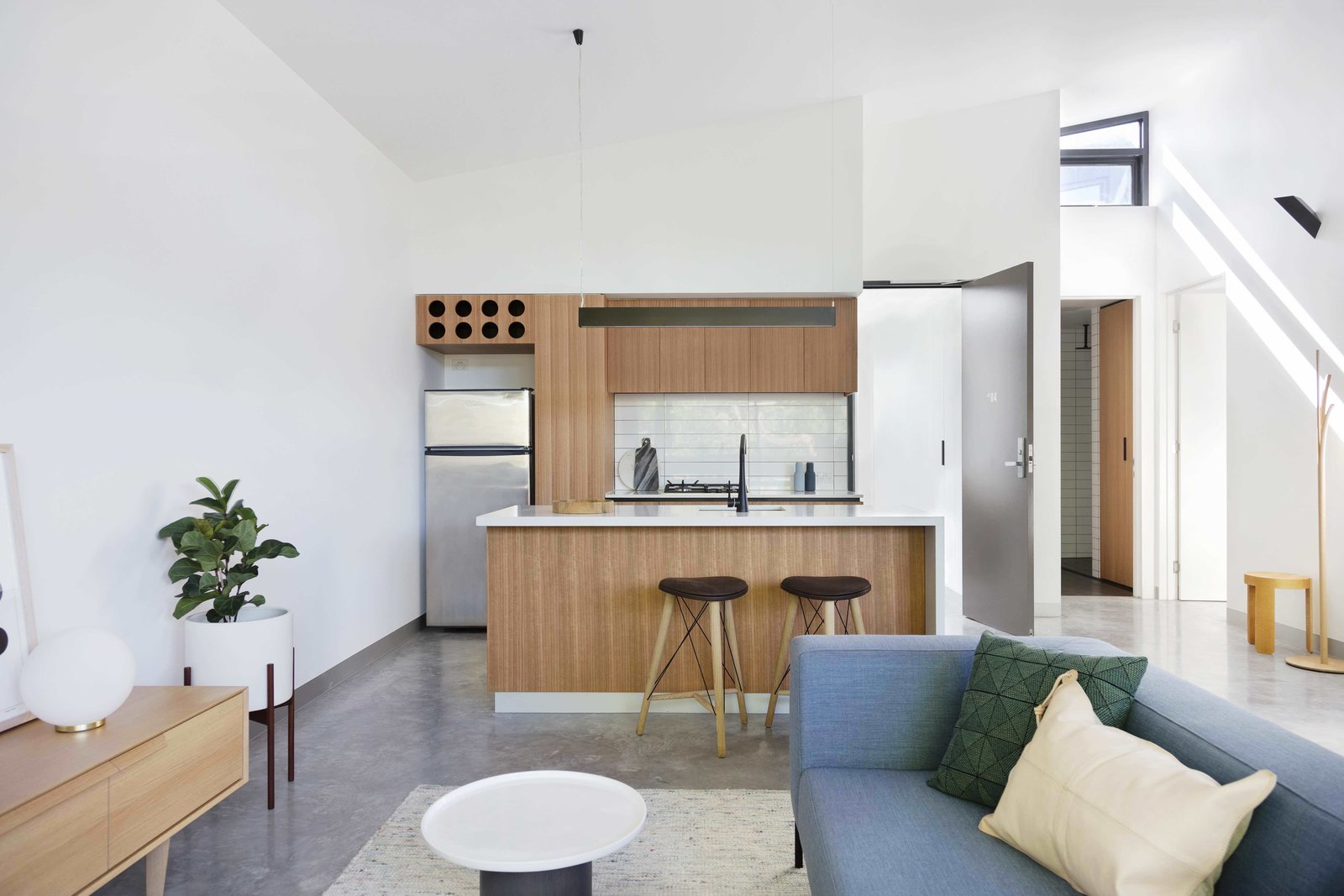 Tagged: Kitchen, Wood Cabinet, Concrete Floor, Refrigerator, Ceramic Tile Backsplashe, Range, and Undermount Sink.  Photo 5 of 14 in What Looks Like a Single Dwelling in Melbourne Actually Holds Six Walk-Up Apartments