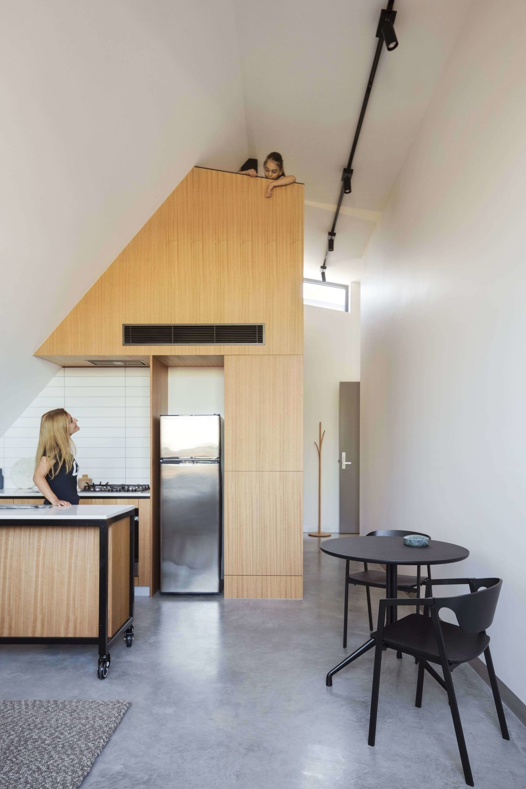 Tagged: Kitchen, Wood Cabinet, Concrete Floor, Refrigerator, Ceiling Lighting, and Cooktops.  Photo 14 of 14 in What Looks Like a Single Dwelling in Melbourne Actually Holds Six Walk-Up Apartments