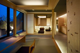 """7 Modern Japanese Hotels That Will Help You Find Your Zen - Photo 7 of 7 - This Kyoto hotel has modern rooms that are inspired by """"machiyas""""—or traditional wooden townhouse homes that are typically found in Kyoto—and include tatami beds and aromatic cypress bathtubs."""