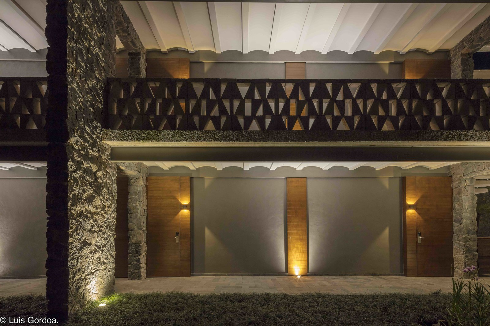 The structural combination of concrete and regionally-sourced stone is reflective of Mexican architecture and alludes to the monuments of the ancient Aztecs. Tagged: Exterior, Stone Siding Material, Concrete Siding Material, and Wood Siding Material.  Photo 4 of 12 in A New Hotel in Morelos Combines Local Mexican Elements With Brutalist Architecture